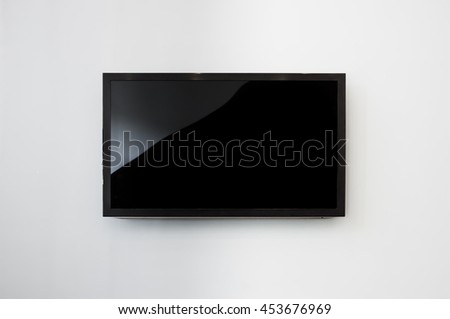 Black LED tv television screen mockup / mock up, blank on white wall background