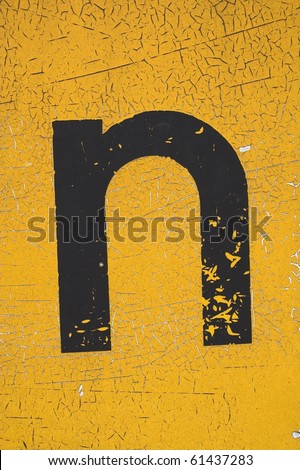 Black letter n on yellow grungy background - stock photo
