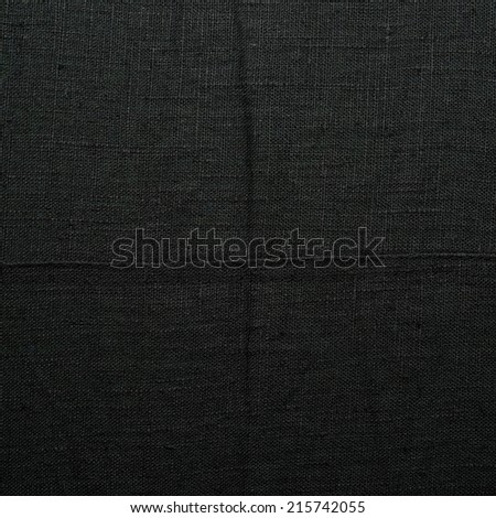 Black linen cloth material fragment as a background texture composition