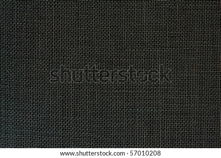 Black linen fabric as background - stock photo