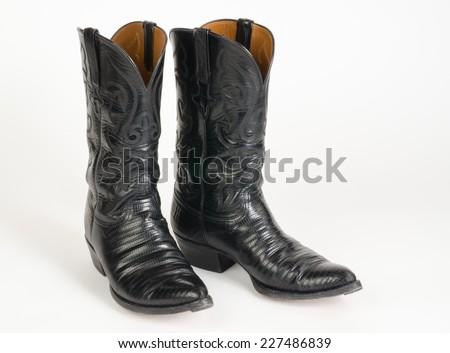 Black Lizard Skin Cowboy Boots. - stock photo