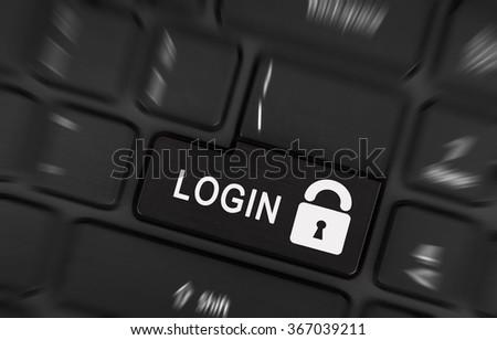 Black login button on modern laptop keyboard - stock photo