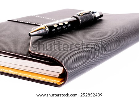 black luxury organizer with pen - stock photo