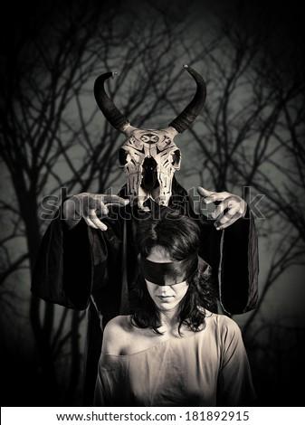 Black magic sacrifice - stock photo
