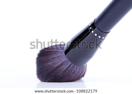 black make-up brushes on white background - stock photo