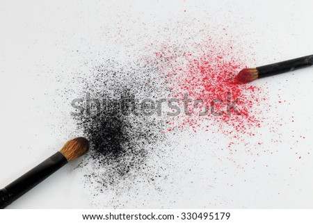 black makeup powder with brush on white background