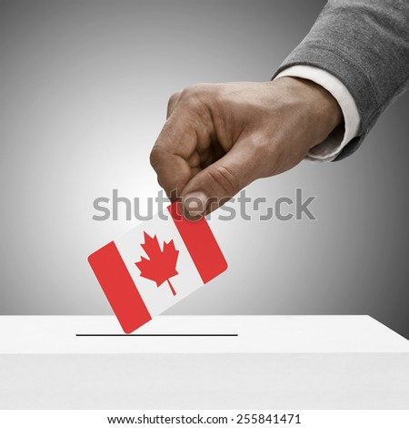 Black male holding flag. Voting concept - Canada - stock photo