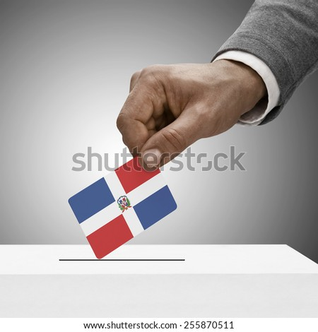 Black male holding flag. Voting concept - Dominican Republic - stock photo