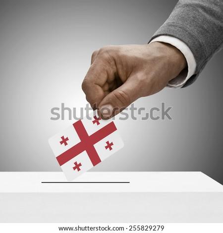 Black male holding flag. Voting concept - Georgia - stock photo