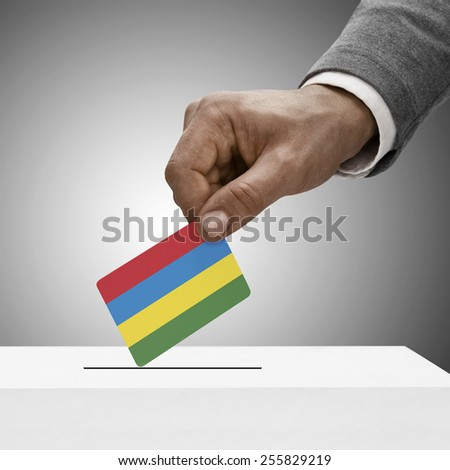 Black male holding flag. Voting concept - Mauritius - stock photo
