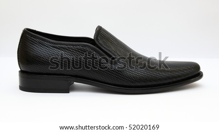 Black male shoes, crocodile textured - stock photo