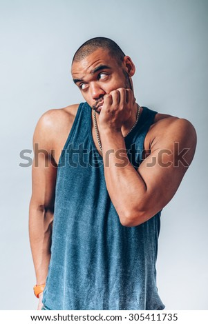 black man backs his chin with his fist
