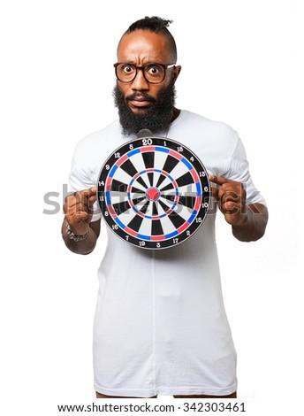 black man holding a dartboard - stock photo