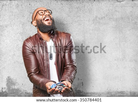 black man holding poker chips - stock photo