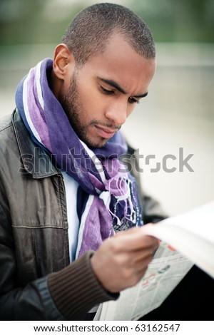black man portrait with newspaper - stock photo