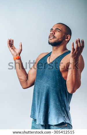 Black man praying to god