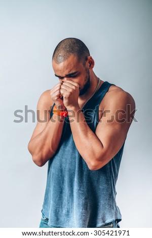 Black man praying to god - stock photo