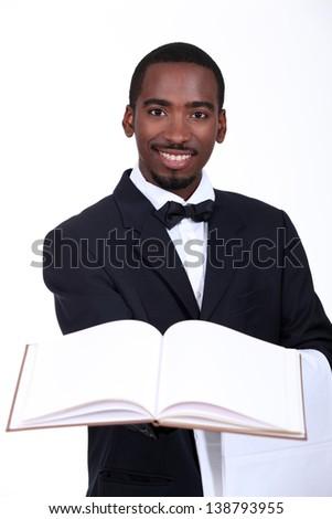 black man presenting a book - stock photo