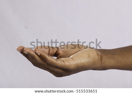 Black man's hand, palm up to receive