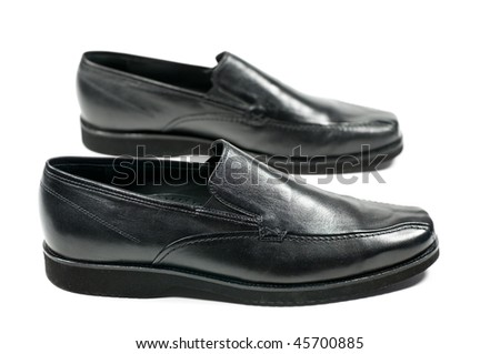 Black man's shoes isolated on a white background