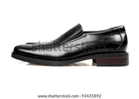 Black man's shoes on a white background.