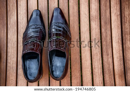Black man shoes on wooden table