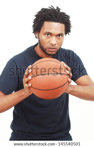 Black man with a basketball - stock photo