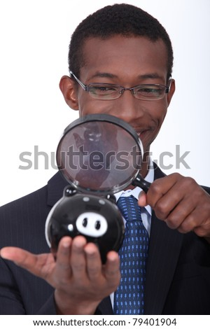 black man with a magnifying glass - stock photo