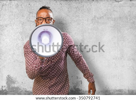 black man with megaphone - stock photo