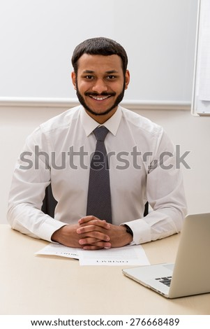 Black manager on the workplace. Smiling clerk.