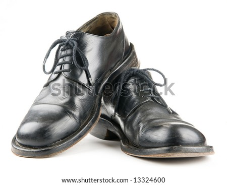 Black mans shoes over white background - stock photo