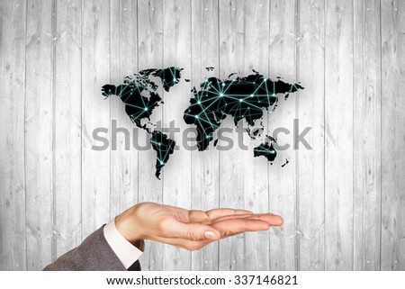 Black map on the gray wood wall background. Pollution concept. Elements of this image furnished by NASA - stock photo