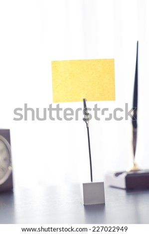 Black mark on the pole for the label standing on a black table. Room for you text. - stock photo