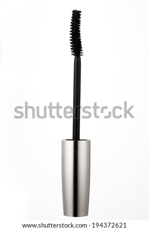 Black mascara on white background - stock photo