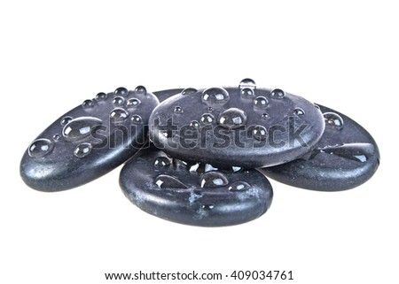 Black massage stones stacked, isolated on white background - stock photo