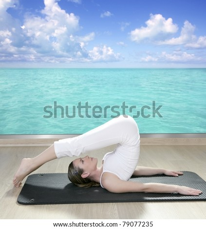 black mat yoga woman window turquoise sea view tropical caribbean [Photo Illustration]