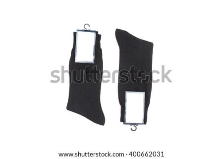 Black men's socks on white background - stock photo