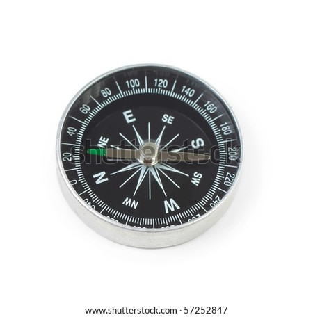 Black metal compass over white