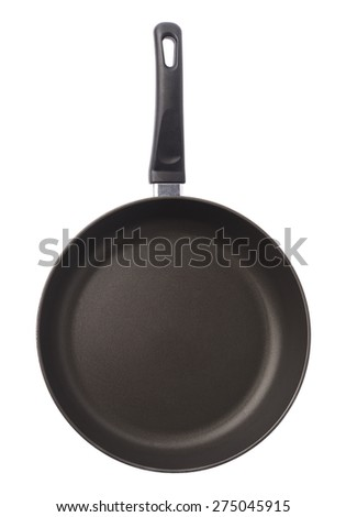 Black metal frying pan with a handle, isolated over the white background - stock photo