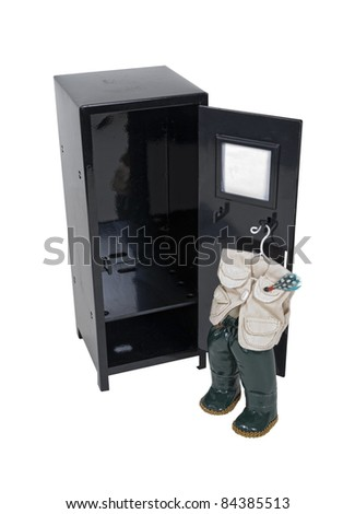Black metal locker with fishing outfit hanging on the inside - path included