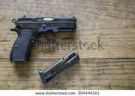 Black Metal 9mm Pistol and Magazine - stock photo