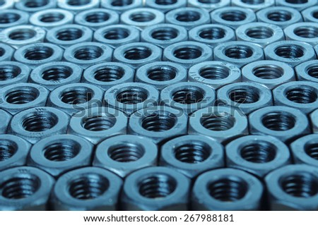 black metal parts and nuts - stock photo