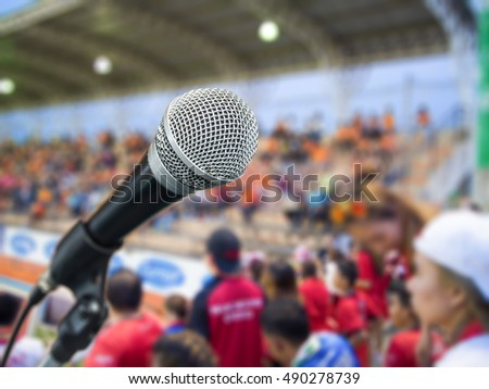 black metallic microphone on blur background on stage
