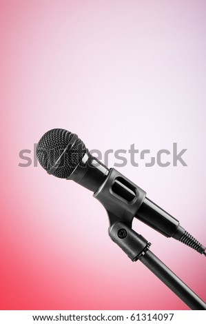 Black microphone against the colorful gradient background