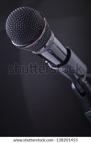 black microphone close up isolated on a black - stock photo