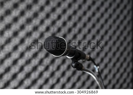 Black microphone in studio booth