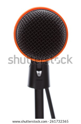 Black microphone with cable on stand isolated on white background - stock photo
