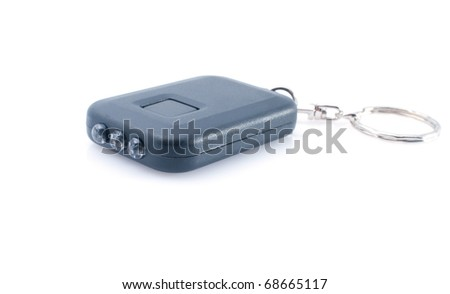 Black mini flashlight on solar batteries on white background