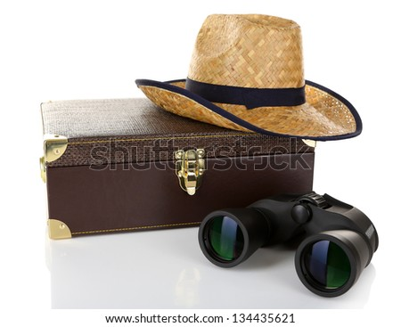 Black modern binoculars with suitcase and straw hat isolated on white - stock photo