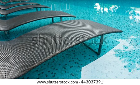 black modern seating area in the pool